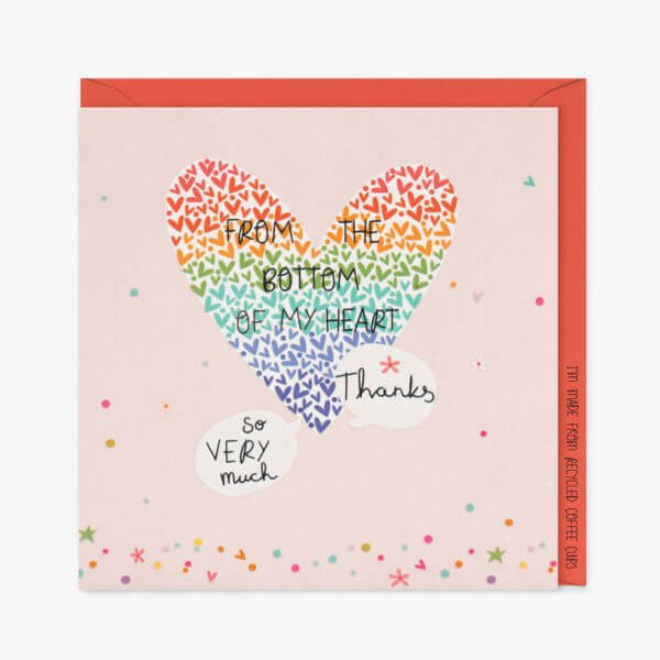A pink Thank You card with sprinkles of colourful shiny dots, hearts and flowers with a big rainbow heart made of lots of tiny hearts and the words From the bottom of my heart Thanks so very much