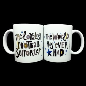 A white mug with the words The Loyalest Football Supporter on one side and 'The world has ever had' on the back.