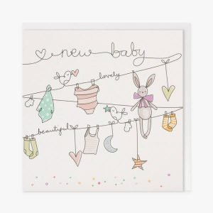 A lovely new baby card suitable for a boy or a girl. A white card with a line drawing of a washing line with baby clothes and a toy rabbit hanging