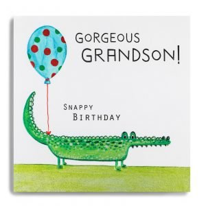 A square card with an image of a cute crocodile holding a spotty balloon with the words Gorgeous Grandson Snappy Birthday printed on it.