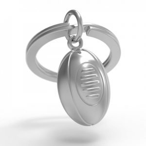 A solid zinc rugby ball on a key ring