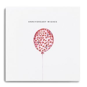 A white square card with a balloon image that has been made with other hearts and finished with little diamante jewels. The wording Anniversary Wishes are printed above the balloon.