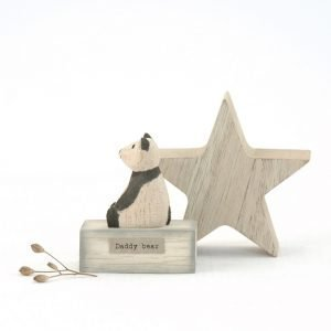 A cute little carved wooden panda bear on a wooden block with the words Daddy Bear printed on it.
