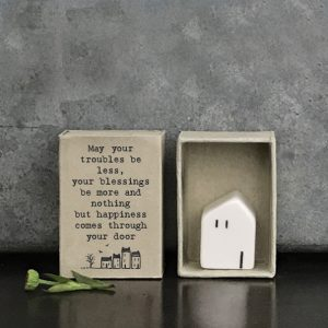 A sweet little porcelain house in a little matchbox with the words May your troubles be less your blessings be more and nothing but happines comes through your door.