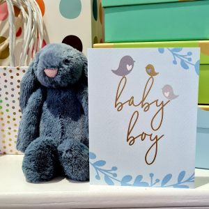 A new baby boy card in blues with three little birds sitting on the word baby boy in gold foil