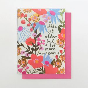 A beautifully floral card from the Flower Power range from Stop The Clock. The card is covered in flowers and has the wording A little bit older and a lot more awesome printed on it.