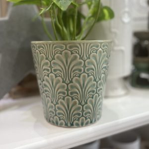 A beautiful ceramic pot cover with an elaborate fan pattern glazed in dusky blue