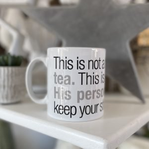 A white mug with the words 'This is not a typical mug of tea. This is Dads cuppa. His personal brew. So keep your sticky hands off. printed on it.