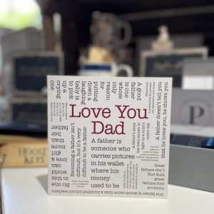 A white typographic card with a variety of printed words describing how much you feel about your dad.