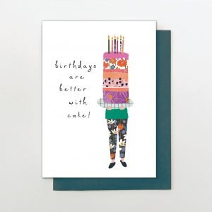 A sweet card from Stop The Clock designs with an image of someone carrying a huge cake which is made up of colourful patterned layers and the words