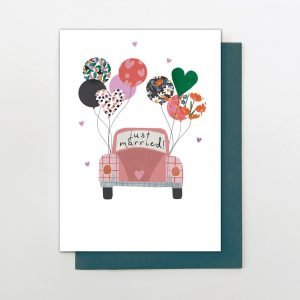 A lovely card from Stop The Clock Designs with an image of a wedding car on the front of it which has colourful patterned balloons attached to it.