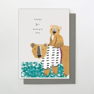A sweet card from Stop The Clock Designs with an image of a daddy bear with a baby bear on it's back and the words Happy 1st Daddy's DAy printed on it.