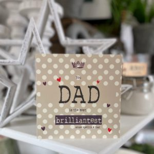 A taupe coloured spotty card with the words You Dad is the most Brilliantest scuse spellin and that printed on it.