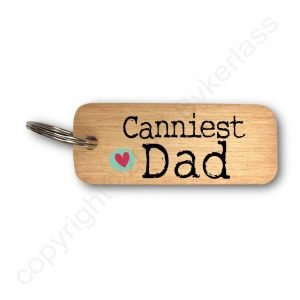 A wooden keyring with the words Canniests Dad printed on it.