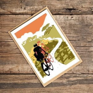 A scenic card of two cyclists out on a country road.