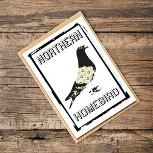 A white card with an image of a homing pigeon on it and the words Northern Homebird printed on it.