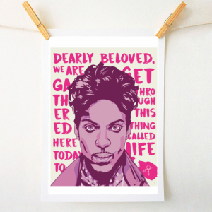 A print of the pop star Prince with the words from his song Lets Go Crazy printed in the background.