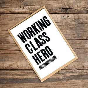 A white card with the words Working Class Hero printed in black on it.