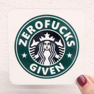 A coaster with a comedy version of the Starbucks logo which has Zerofucks Given printed on it.