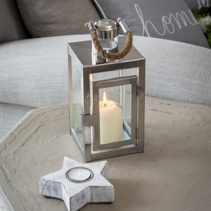 A rectangular 27cm tall glass and silver metal lantern with a chunky rope handle. Holds a large pillar candle
