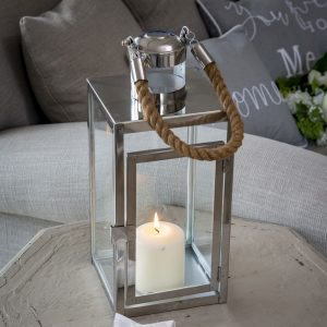 A rectangular 40cm tall glass and silver metal lantern with a chunky rope handle. Hold a large pillar candle