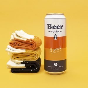 A beer can holding 3 pairs of men's beer socks. a yellow lager pair, a black stout pair and an orange ale pair